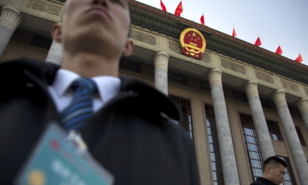 Security staff stand guard outside the Great Hall of the People in Beijing