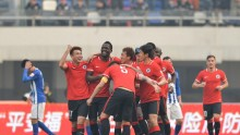 Liaoning Whowin players celebrate after a goal