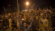 Pakistani demonstrators demand Prime Minister Sharif to step down from his position for allegations of mass voting fraud
