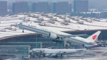 Aircraft are seen at the Beijing Capital International Airport on November 23, 2015 in Beijing, China.